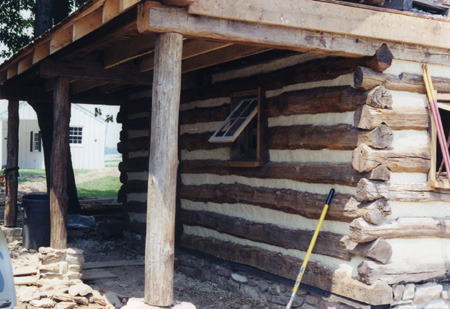 New log cabin with hand hewn logs for Hand hewn log cabin
