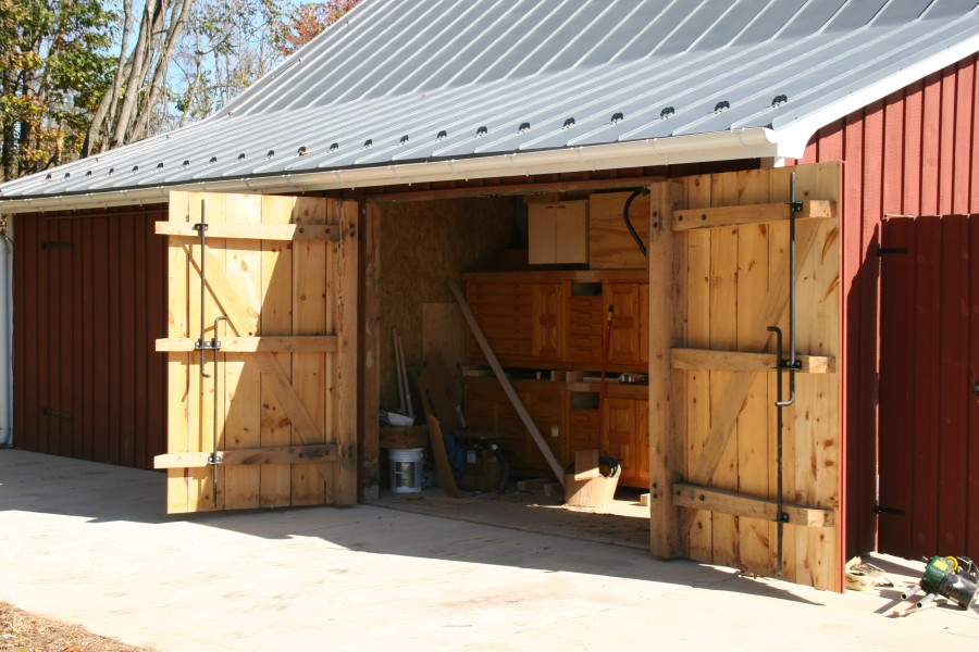 Historic corn crib adaptively reused for equipment and for Lean to garage addition