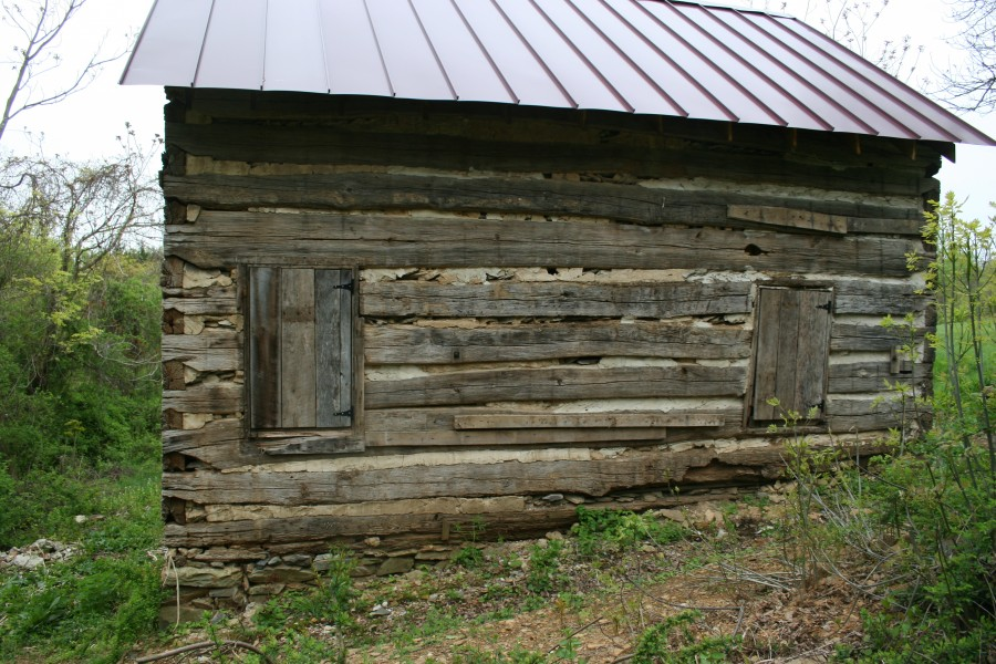Restoration of a log house for Chinking log cabin