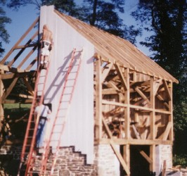 Structure enclosed with prepainted vertical barn siding.