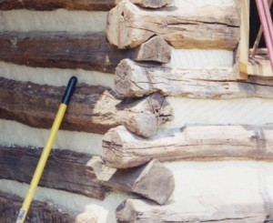 Hand hewn, hand fitted log cabin timbers, outside corner. This is a brand new cabin and yet the finish is so skillful, that it has fooled the experts into believing that it is a historic dwelling.