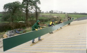 Adare, Ireland, fifty foot roll formed roof pans span full run of the roof, no horizontal seams.