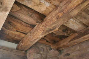 The Ceiling In the Parlor Level Still Shows the Original Log Joists and Plank Flooring