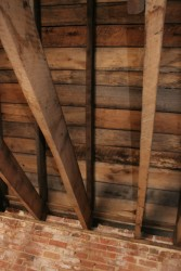 Reclaimed Rough-Sawn Boards Form Ceiling of Second Floor