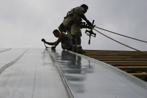 Hand-Crimped Standing Seam Roofing Being Installed