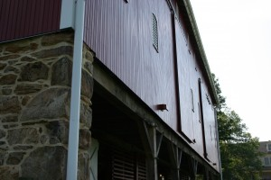New Straw Doors, Fir Siding, and Repointed Stonework
