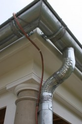 Gutters and Downspouts are Soldered For a Watertight Seal -- Note Braided Copper Lightning Suppression System Conductor