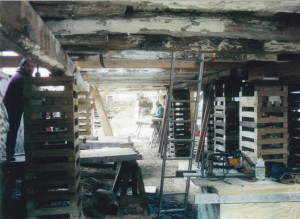 Cribbing in the Parlor Level Supports the Barn During Foundation Repairs