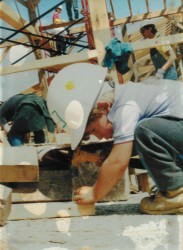 Young Dillon, helping nail flooring at the Malabar Farm raising in Lucas, OH, circa 1994.