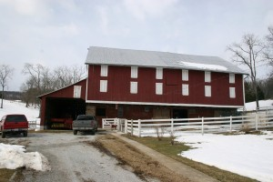 The barn as it appeared in February of 2010.  Its outwardly sound appearance hid considerable frame deterioration.