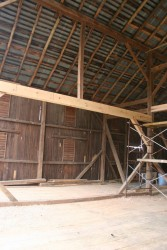 A modification for modern uses:  This heavy carrying beam allows equipment to pass deeper into the barn for hay storage.