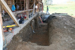 Barn bridge excavated to install drainage and concrete retaining wall to resist ground heave against the stonework.