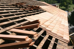 "West side shingles in progress, showing triple coverage of highest-grade 24"" clear cedar shingles."