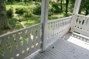 The porches are railed with an interesting and unique shaped slat baluster, but the rails have suffered the same deterioration which is slowly causing the porch roof to sag.