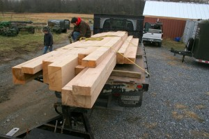 A load of fresh-cut oak timbers arrives from our sawmill.
