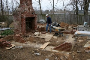 After our careful deconstruction, new solid footings and a brick foundation start the road to recovery.