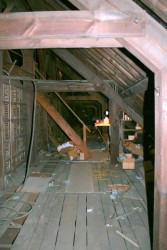 High above the floor of the nave and aisles, the attic spaces are strictly utilitarian, full of construction debris, and hard to access for maintenance.