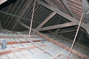 "The large main trusses hold up the slate roof and the decorative vaulted plaster ceiling.  The large (8""x12"") oak timbers are still doing a great job after 150 years of service, but need a little maintenance to ensure they keep up the good work for another century and a half."